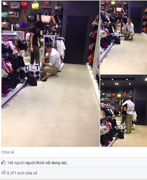 Bức ảnh cúi xuống thử giày cho bạn gái và tranh cãi chọn bạn trai - Ảnh 1