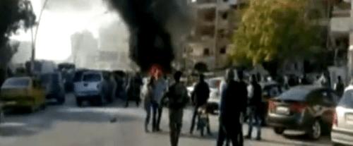 IS tấn công thành phố có căn cứ Nga, 23 người thiệt mạng - Ảnh 1