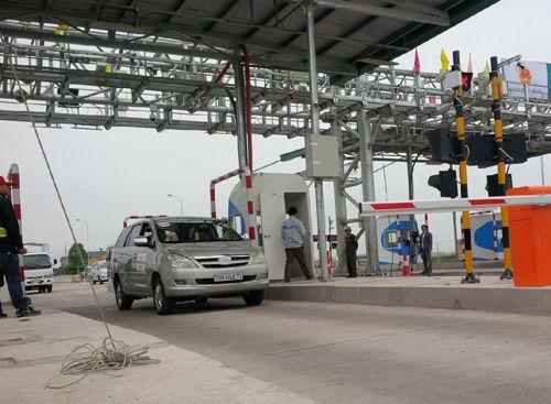 Thu phí tự động không dừng trên QL1 và đường Hồ Chí Minh - Ảnh 1