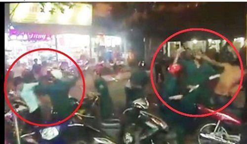 6 dân quân dùng dùi cui đánh nhóm thanh niên trên phố - Ảnh 1