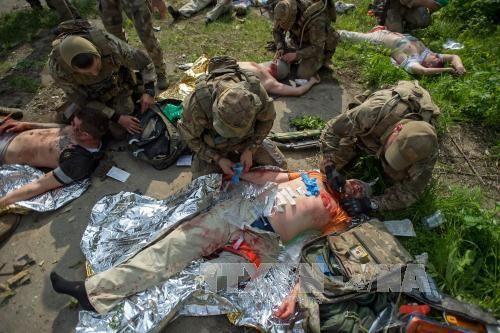 Gần 60 binh sĩ Ukraine thiệt mạng tại Donbass - Ảnh 1