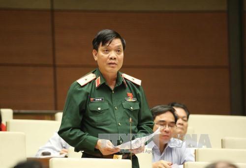 Quốc hội thống nhất nâng hạn tuổi phục vụ tại ngũ - Ảnh 1