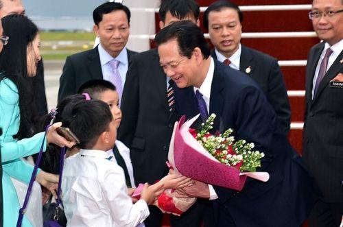 Thủ tướng Nguyễn Tấn Dũng tới Thủ đô Kuala Lumpur, Malaysia - Ảnh 2