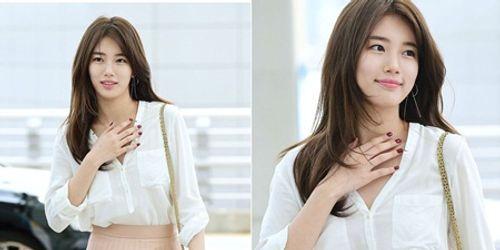 Suzy chụp hình cùng tượng sáp giống nhau như hai giọt nước - Ảnh 6
