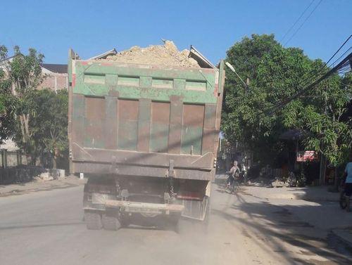 Dân kêu khổ vì xe phục vụ dự án quốc lộ mới phá nát quốc lộ cũ - Ảnh 10