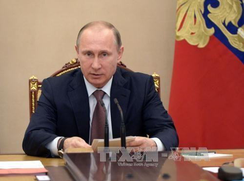 Tổng thống Nga hợp nhất Crimea vào Vùng liên bang - Ảnh 1