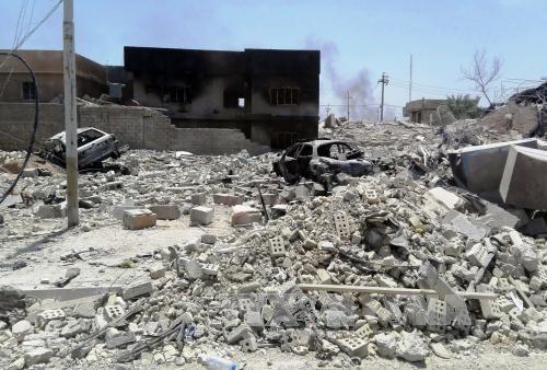 Nhiều thủ lĩnh IS tại Iraq tháo chạy sang Syria - Ảnh 1