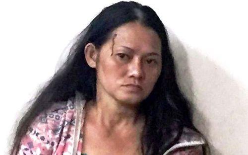 Người phụ nữ nghiện chém bị thương 4 bảo vệ dân phố - Ảnh 1