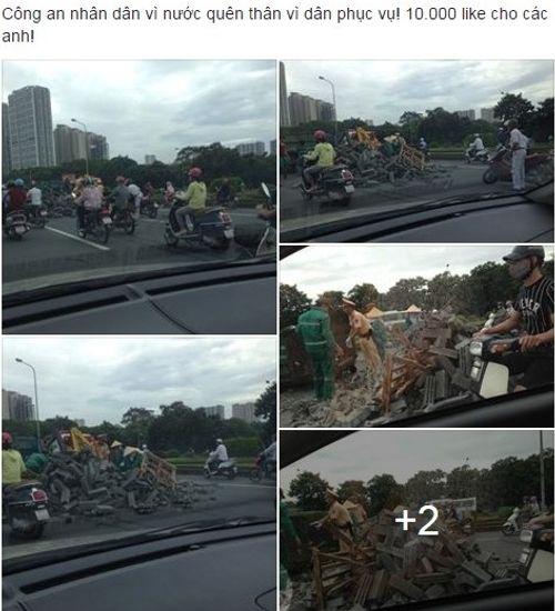 Cảnh sát giao thông Hà Nội dọn đống gạch bị đổ giữa đường - Ảnh 1