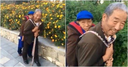 Hạnh phúc chẳng ở đâu xa: cụ ông địu người vợ ốm yếu đi dạo phố mỗi ngày - Ảnh 2