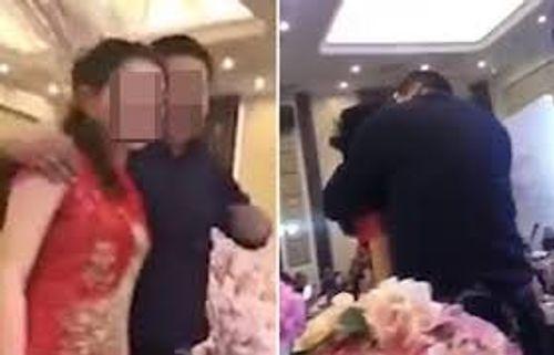 Khách mời đám cưới choáng váng khi cha chồng tóm lấy cô dâu hôn say đắm - Ảnh 1
