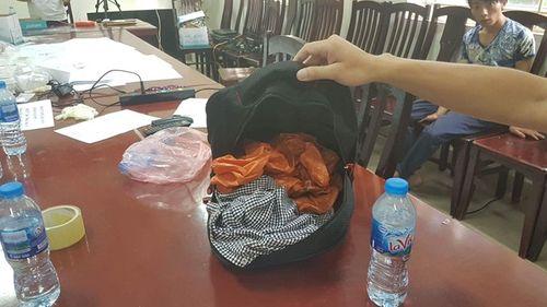 Bắt giữ đối tượng chở thuê 26 bánh heroin tại bến xe Mỹ Đình, Hà Nội - Ảnh 2