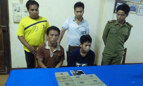 Bắt 2 người Lào mua bán 10 bánh heroin - Ảnh 1