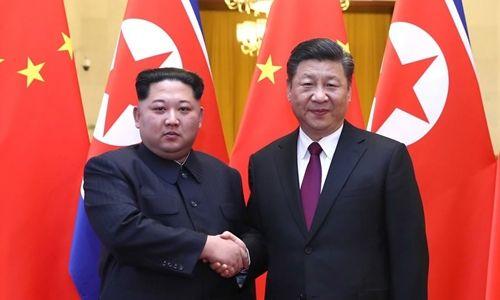 Ông Kim Jong-un gặp Chủ tịch Trung Quốc Tập Cận Bình - Ảnh 1