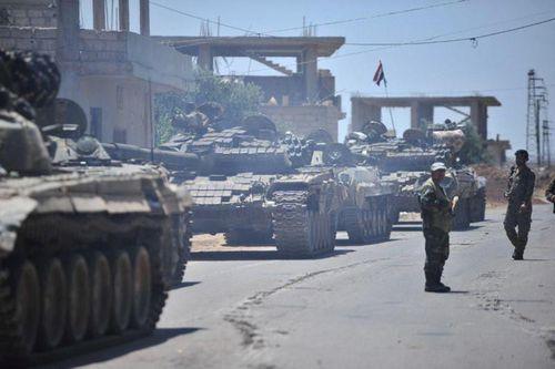 Quân nổi dậy thua trận, gần như bị đánh bật khỏi Tây Nam Syria - Ảnh 1