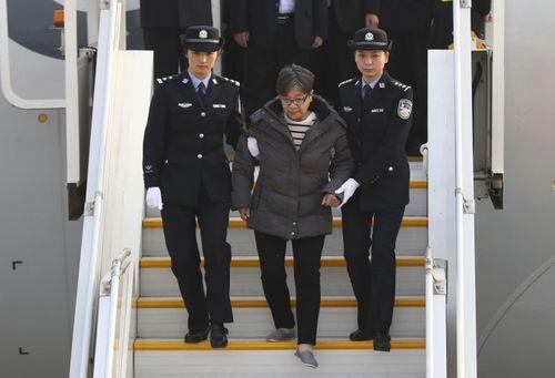 Nghi phạm tham nhũng Trung Quốc đầu thú sau 13 năm lẩn trốn - Ảnh 1