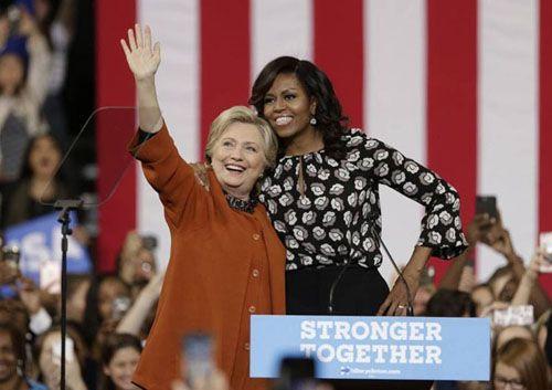 Clinton mong đệ nhất phu nhân Obama làm việc trong nội các - Ảnh 1