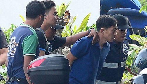 Nghi phạm Triều Tiên mặc áo chống đạn trước khi được thả - Ảnh 1