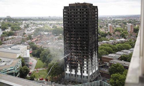 Những hình ảnh hoang tàn bên trong tòa chung cư 24 tầng sau vụ hỏa hoạn nghiêm trọng - Ảnh 1