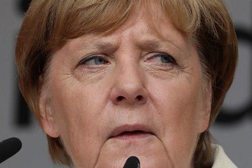 Bà Merkel khẳng định chính sách chào đón người tị nạn được quyết định dựa trên quan điểm chính trị và sự nhân đạo. Ảnh: Reuters