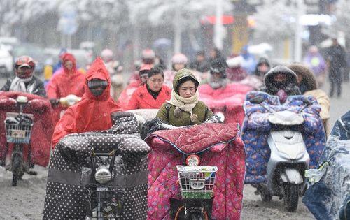 Đợt không khí làm nhiệt độ ở Trung Quốc xuống âm 41 độ đang tràn xuống Việt Nam - Ảnh 1