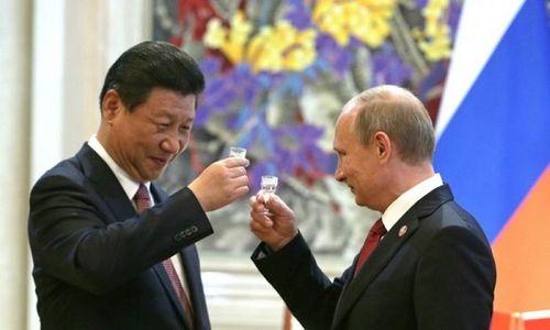 Ông Tập Cận Bình chúc mừng ông Putin tái đắc cử Tổng thống Nga - Ảnh 1