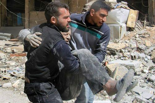 Syria: Phiến quân tấn công bằng rocket, hơn 30 người thiệt mạng - Ảnh 1