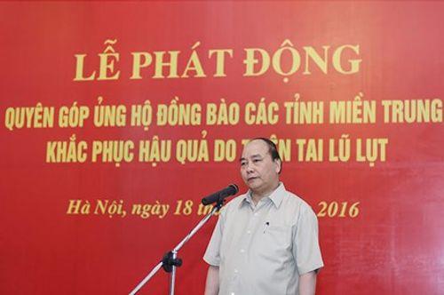 Thủ tướng và các Phó Thủ tướng ủng hộ đồng bào miền Trung - Ảnh 1