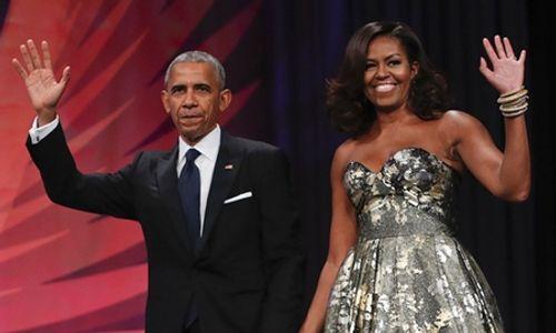 Vợ chồng ông Obama ký hợp đồng kỷ lục 60 triệu USD viết hồi ký - Ảnh 1