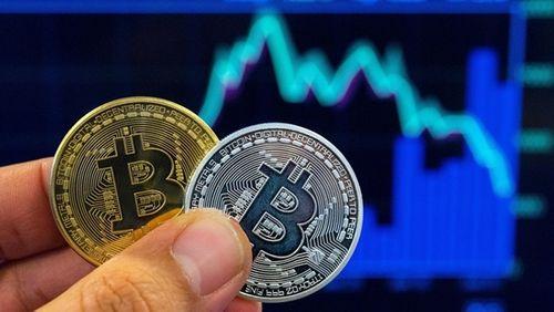 """Giá Bitcoin hôm nay 29/3/2018: Bitcoin lại """"bốc hơi"""" thêm 300 USD - Ảnh 1"""