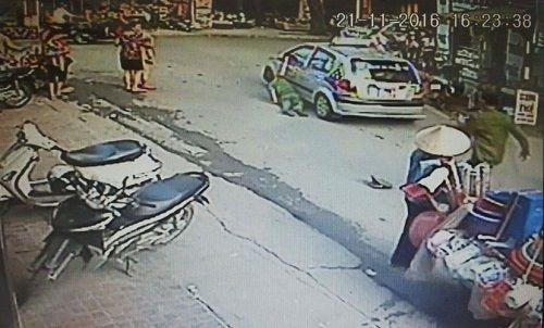 Hà Nội: Tạm giữ hình sự lái xe taxi kéo lê cảnh sát - Ảnh 1