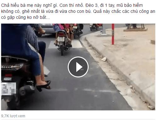"""Bà mẹ """"gan dạ nhất năm"""" vừa lái xe vừa cho con bú ngay trên phố Hà Nội - Ảnh 1"""