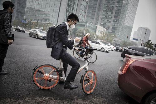 """Dịch vụ """"Uber"""" xe đạp nở rộ ở Trung Quốc - Ảnh 2"""