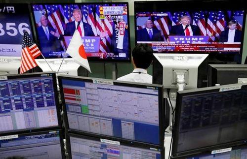 """Chứng khoán Mỹ tăng điểm dù ông Trump trở thành """"Tân Tổng thống"""" - Ảnh 1"""