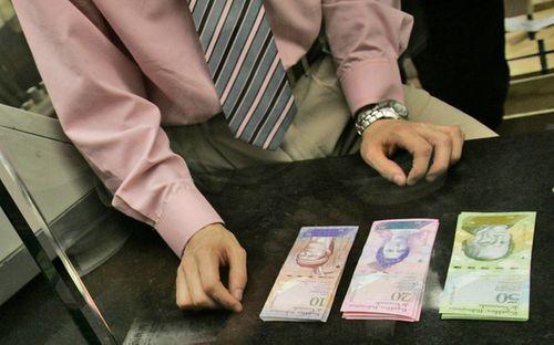 Venezuela đổi mệnh giá 9 loại đồng tiền do lạm phát - Ảnh 1