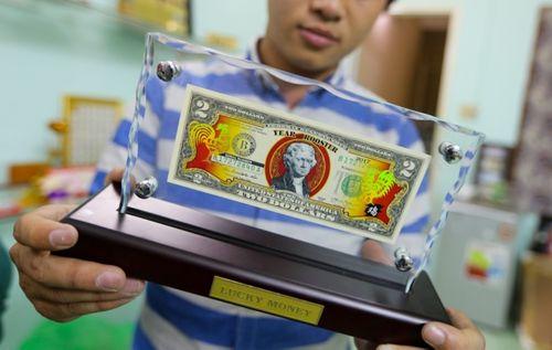 Điểm danh những tờ tiền in hình gà được săn đón dịp tết Đinh Dậu - Ảnh 7