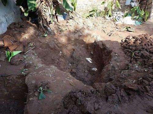 Nghi phạm chôn xác 2 bé gái trong vườn nhà khai gì tại cơ quan công an? - Ảnh 2