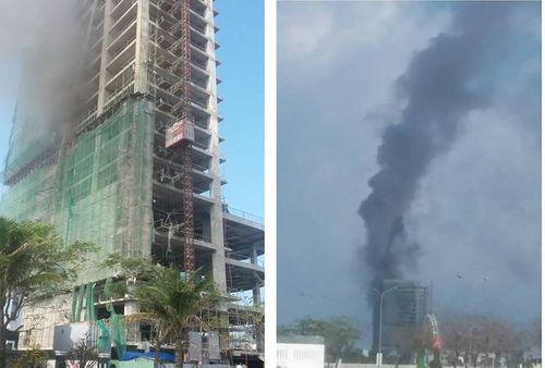 Tòa nhà 18 tầng đang xây bốc cháy, cột khói cao hàng chục mét - Ảnh 1