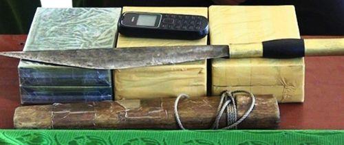 Bắt kẻ vận chuyển thuê 6 bánh heroin từ Lào về Việt Nam - Ảnh 1