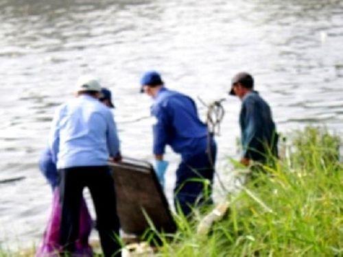 Điều tra vụ thi thể người đàn ông bị trói chân tay trôi trên sông - Ảnh 1