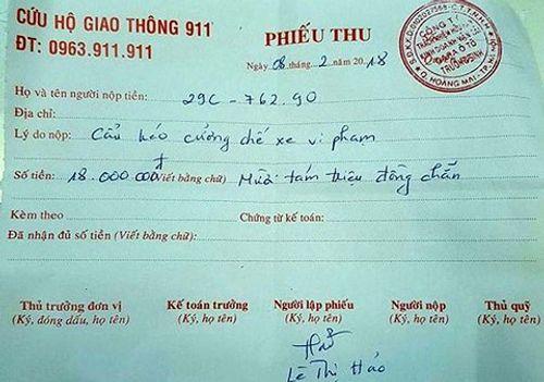 Chủ xe vi phạm ở Hà Nội phải trả 18 triệu phí cẩu xe: Lãnh đạo Đội CSGT số 14 nói gì? - Ảnh 1
