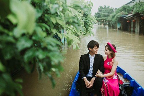 Ấn tượng với bộ ảnh cưới giữa cảnh mưa lũ ở Hội An của cặp đôi Sài Gòn - Ảnh 7