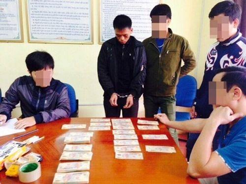 Vận chuyển 200 triệu tiền giả về Hà Nội, hai đối tượng bị tóm gọn - Ảnh 1