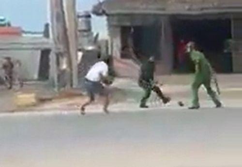 Truy tìm nhóm người chửi bới, tấn công hai cảnh sát ở Quảng Ninh - Ảnh 1