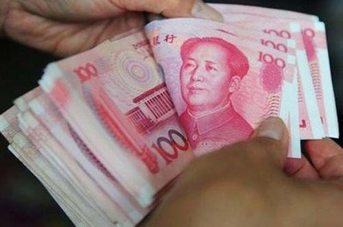 Trung Quốc ấn định mức tiền mặt được rút ở nước ngoài - Ảnh 1