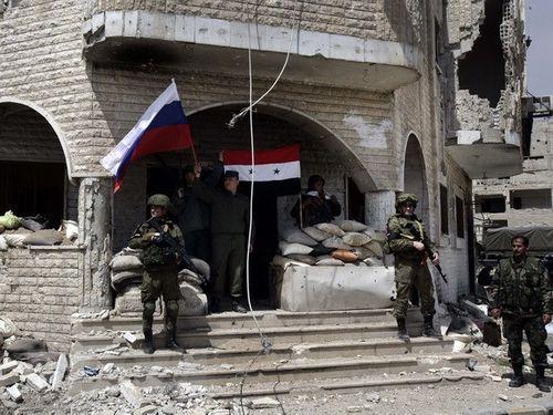 Phiến quân sơ tán khỏi thành trì cuối cùng ở Đông Ghouta - Ảnh 1
