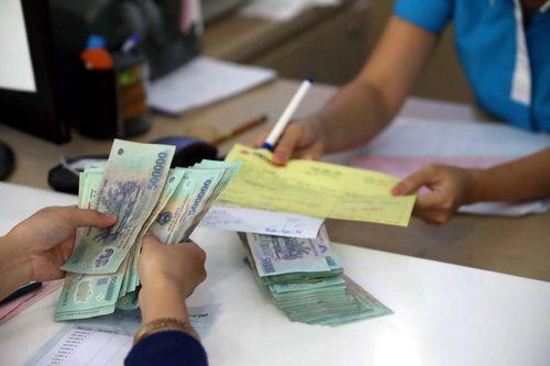 Nhiều ngân hàng điều chỉnh giảm lãi suất đầu vào - Ảnh 1