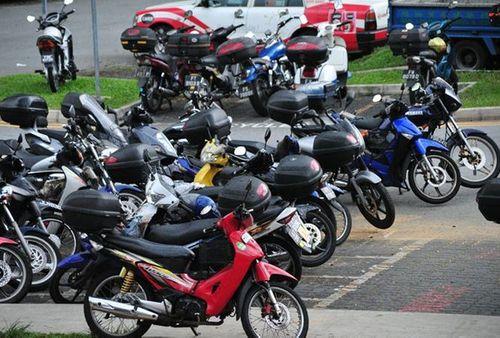 Vứt xe máy cũ để bảo vệ sức khỏe, dân Singapore được trả 2.600 USD  - Ảnh 1