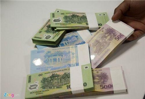 Xử lý cán bộ ngân hàng trục lợi đổi tiền mới, tiền lẻ - Ảnh 1