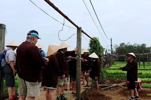 Chùm ảnh: Lễ hội Cầu Bông tại làng rau Trà Quế - Ảnh 14